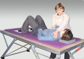 Person lying down on a table learning Alexander Technique